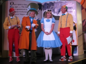 Carissa and Rudy with Special Guests Alice and the Mad Hatter entertain the runners.